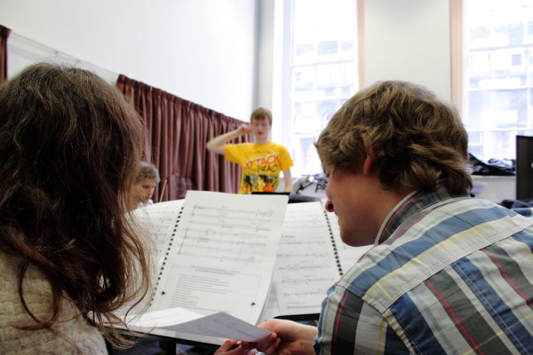 Clarinettist Jonathan Guy and cellist Anna Menzies try to figure out Chris Swithinbank's score.